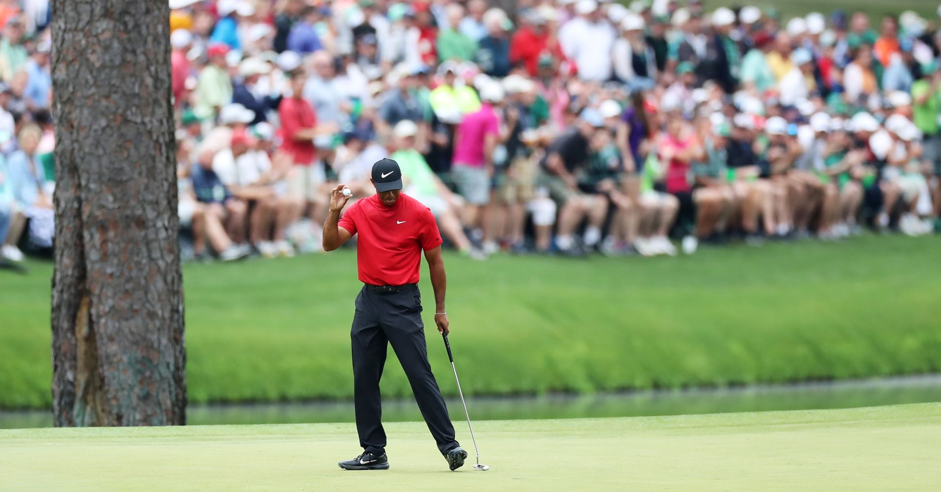 Tiger Woods of the United States reacts on the 15th green during the final round of the Masters at Augusta National Golf Club on April 14, 2019 in Augusta, Georgia.