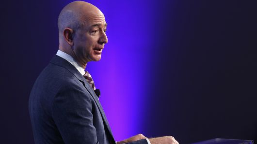 Amazon founder and Washington Post owner Jeff Bezos speaks during the opening ceremony of the media company