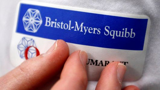 Logo of global biopharmaceutical company Bristol-Myers Squibb is pictured on the blouse of an employee in Le Passage, near Agen, France March 29, 2018.