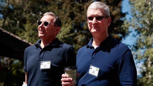 Bob Iger, chief executive officer of The Walt Disney Company, walks with Tim Cook, chief executive officer of Apple Inc., as they attend the annual Allen & Company Sun Valley Conference, July 6, 2016 in Sun Valley, Idaho.