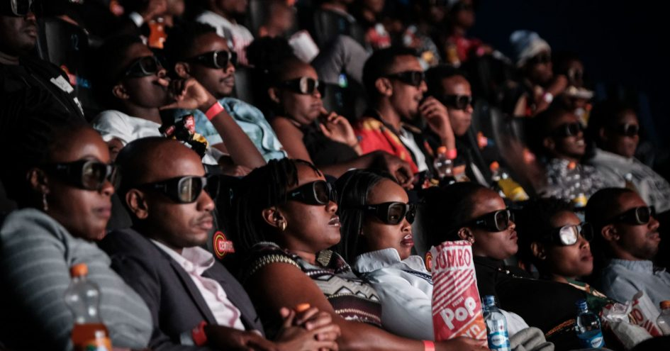"""Invited guests watch the film """"Black Panther"""" in 3D which featuring Oscar-winning Mexico born Kenyan actress Lupita Nyongo during Movie Jabbers Black Panther Cosplay Screening in Nairobi, Kenya, on February 14, 2018."""