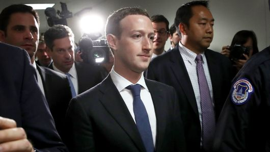 Facebook CEO Mark Zuckerberg (C) leaves the office of Sen. Dianne Feinstein (D-CA) after meeting on Capitol Hill on April 9, 2018 in Washington, DC.