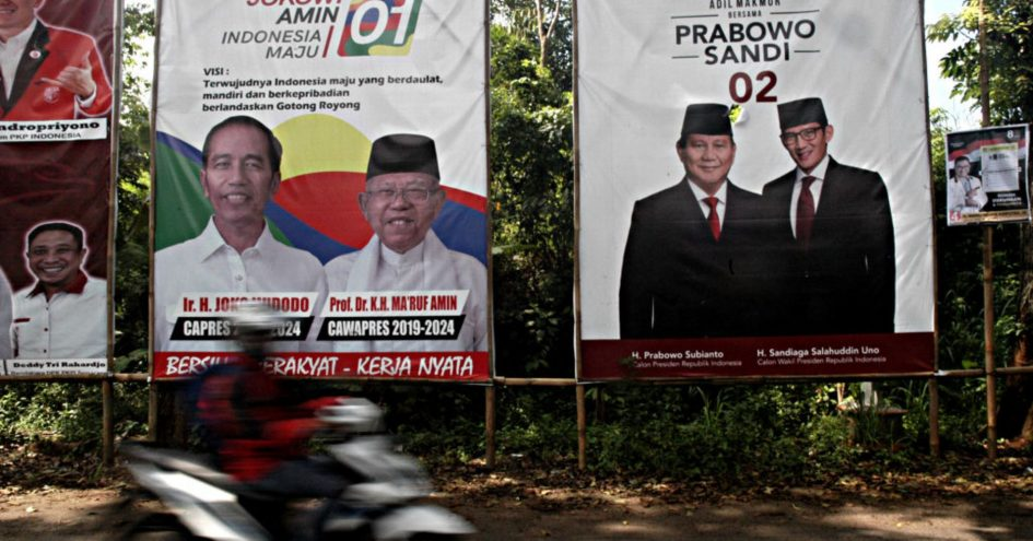 Motorists pass electoral posters in Central Java Province ahead of the presidential and legislative elections. Indonesia is set to hold simultaneous presidential and parliamentary elections on April 17.