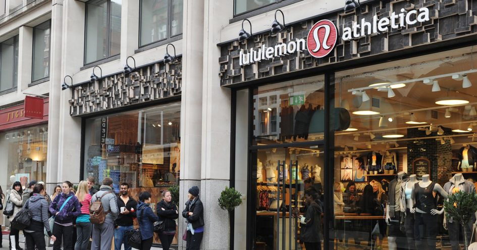 People line up outside a Lululemon Athletica store in London.