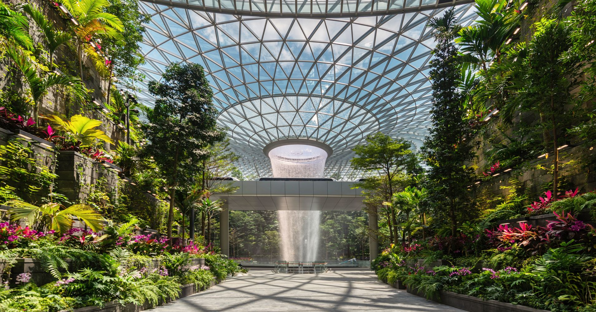 View of the Forest Valley and Rain Vortex from Terminal 1 at the Jewel Changi Airport.