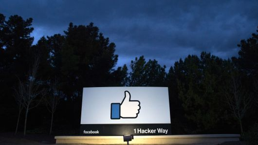 A lit sign is seen at the entrance to Facebook