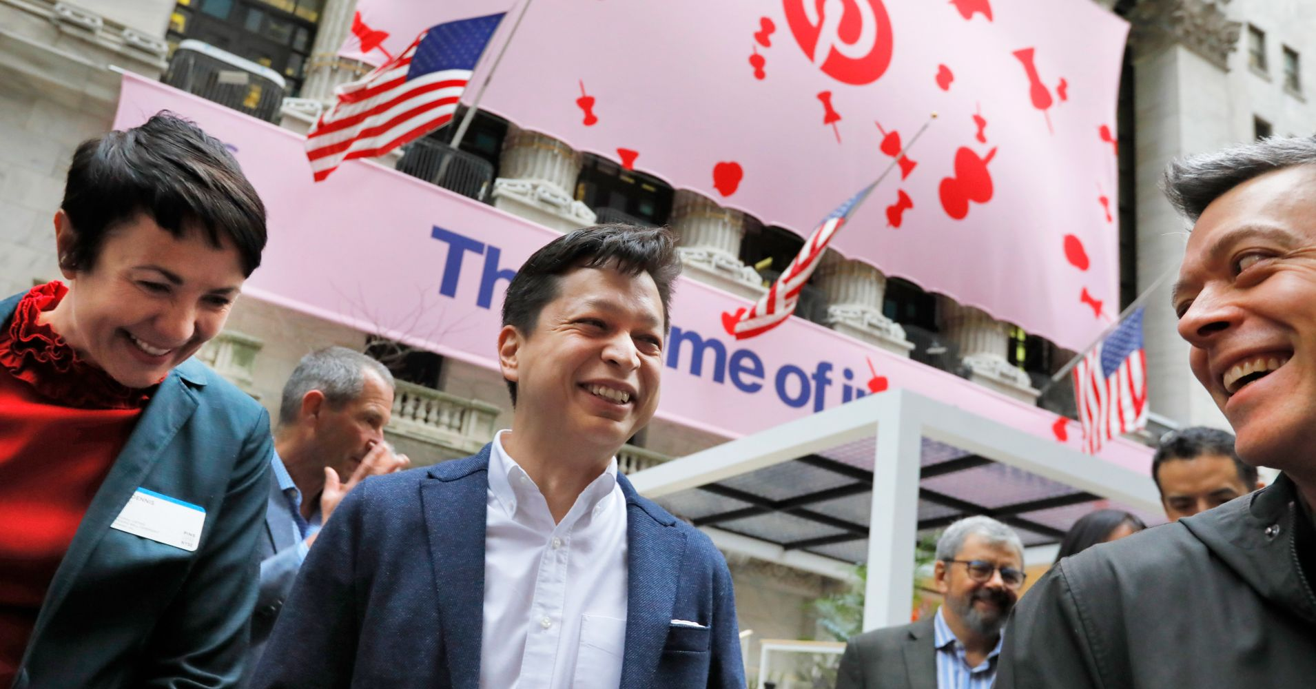 Pinterest co-founder & CEO Ben Silbermann, center, gathers with company employees outside the New York Stock Exchange, Thursday, April 18, 2019, before the Pinterest IPO.