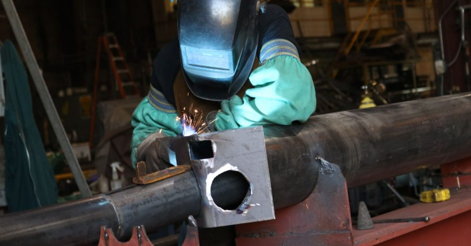 ORANGE COUNTY - AUGUST 7: A welder working on a steel piece at a metal fabrication company on August 7, 2018 in Orange County, New York.