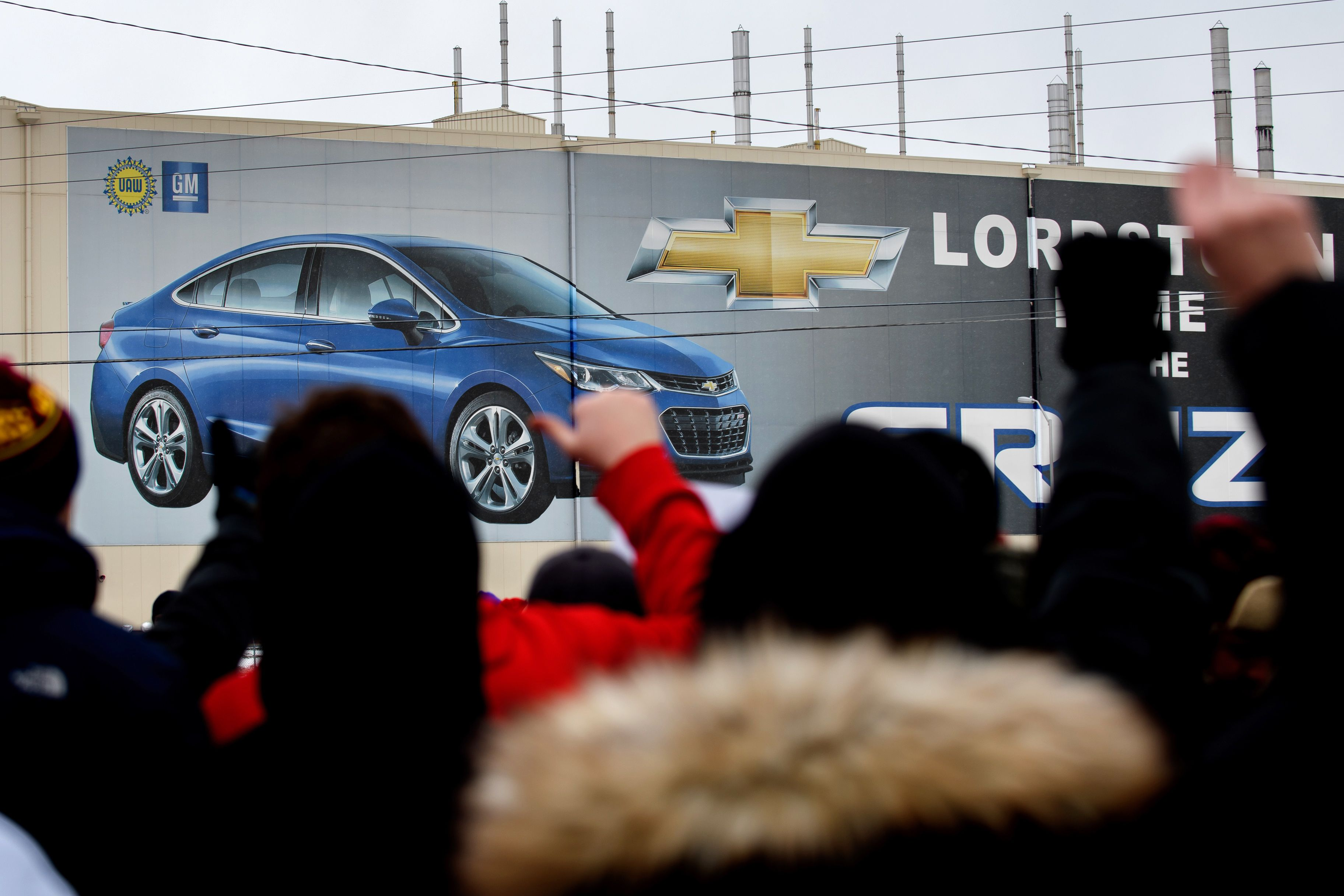 GM says it will invest $700 million to create 450 jobs in three Ohio cities