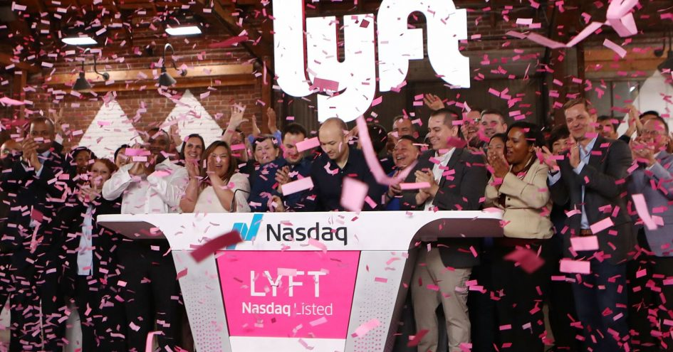 Confetti falls as Lyft CEO Logan Green (C) rings the Nasdaq opening bell celebrating the company's initial public offering (IPO) on March 29, 2019 in Los Angeles, California.