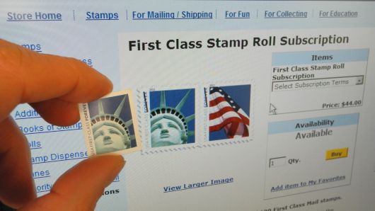 A first class 44-cent US stamp is held up against a screen on April 15, 2011 in Washington,DC. The US post office had egg on its face Friday after realizing that a stamp showing the Statue of Liberty in close up was not taken in New York