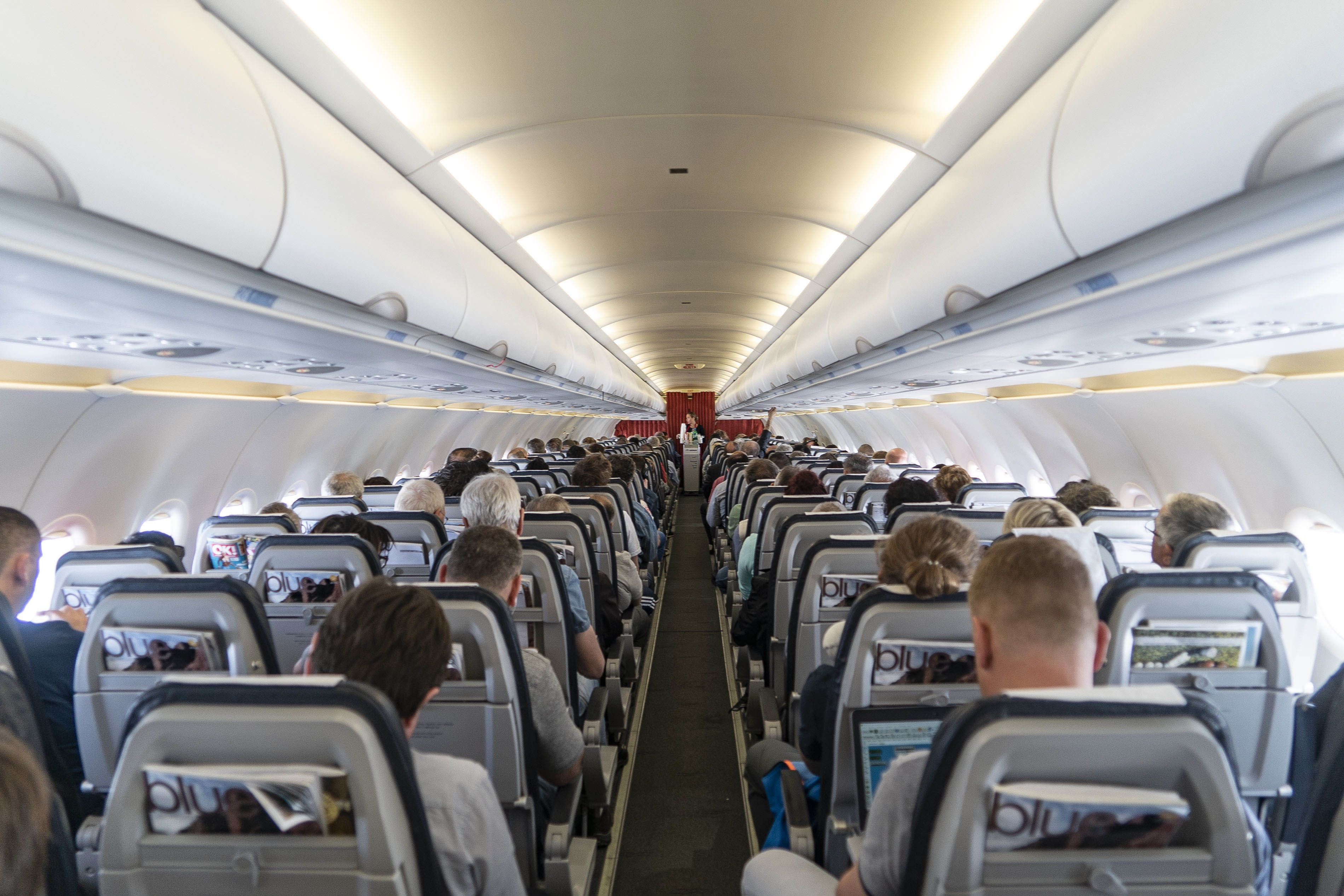 Why do airlines overbook flights?