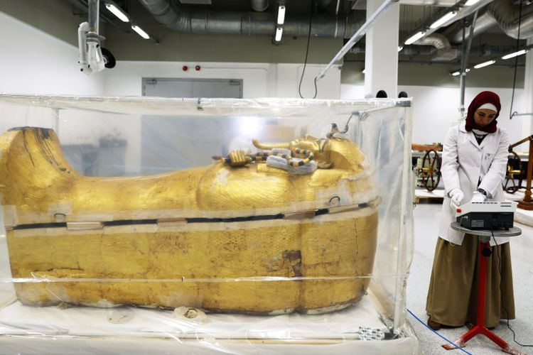 Golden touch up: King Tutankhamun's coffin undergoes first ever restoration at new Grand Egyptian Museum