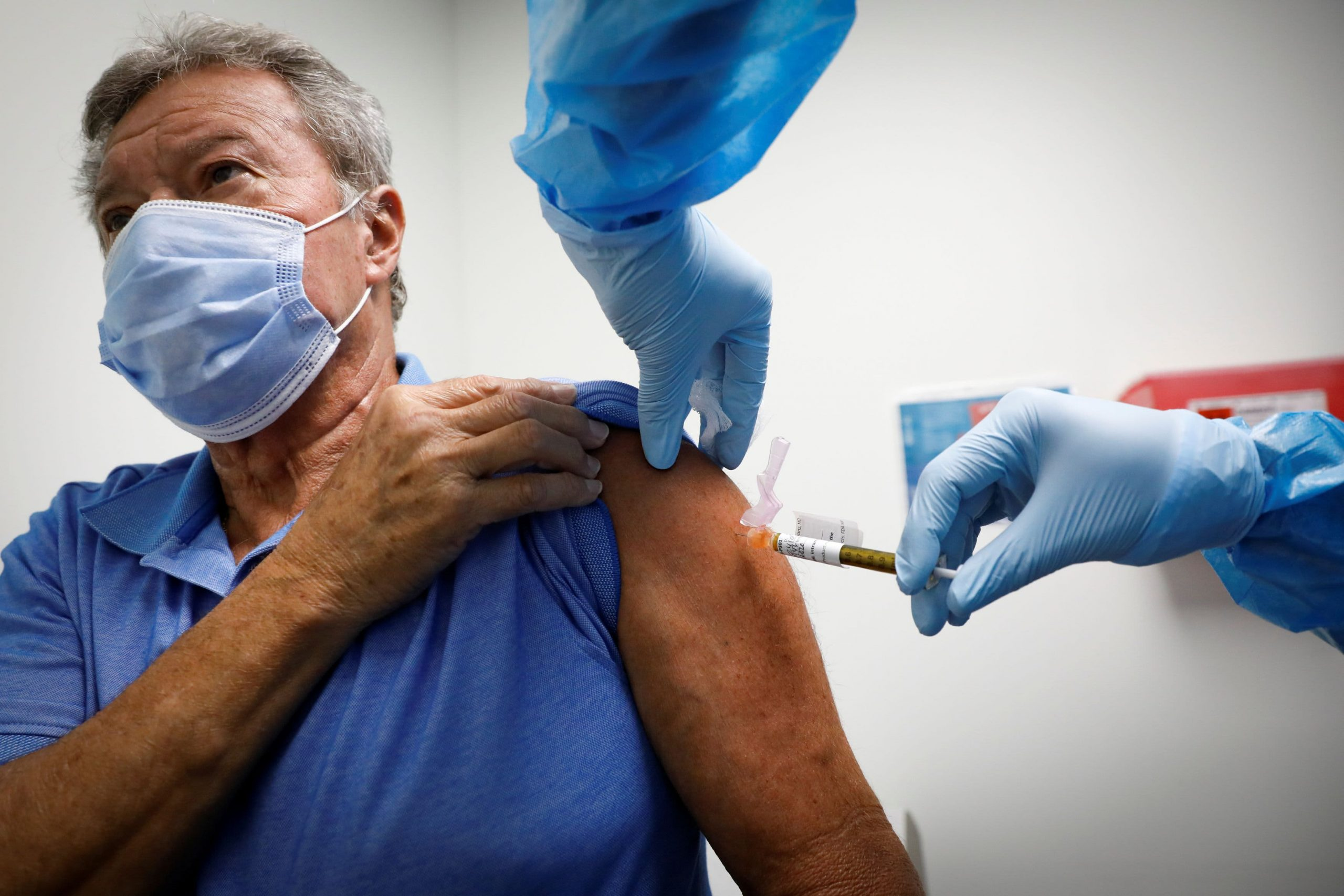 Doctors say CDC should warn people the side effects from Covid vaccine shots won't be 'a walk in the park'