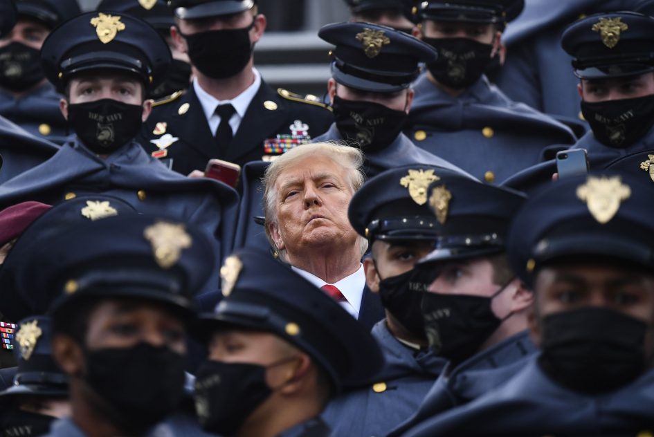 Trump doesn't — then briefly does — wear mask in stands at Army-Navy football game as Covid rages across U.S.