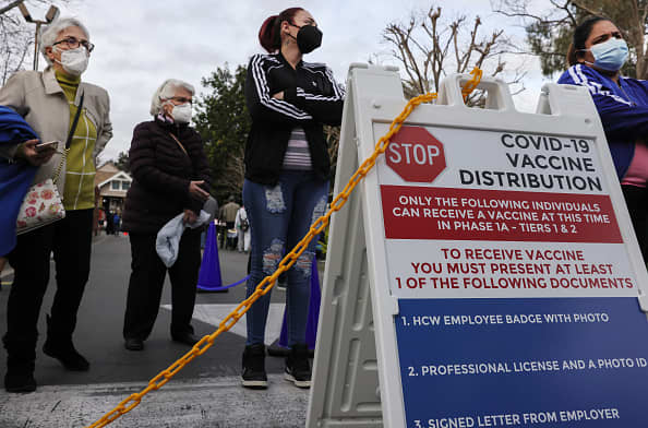 Biden administration to begin shipping Covid vaccine doses to community health centers