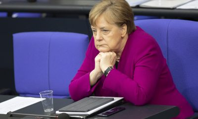 Merkel's bloc hits historic low in polls just as Covid rules start to loosen